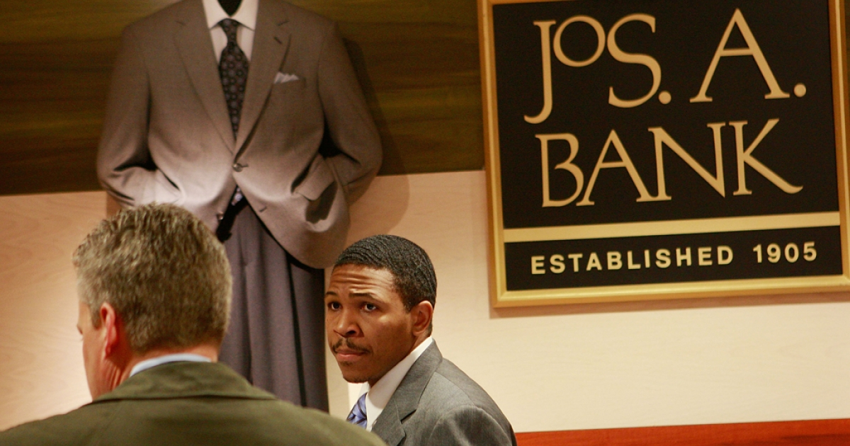 Reggie Woods (R) helps a customer with a purchase at a Jos. A. Bank store on March 18, 2009, in Chicago, Ill. Jos. A. Bank Clothiers, Inc. is famous for the promotional deals it offers to clients, but according to a recent company release consumer interest has waned in the first month of 2013.</p>