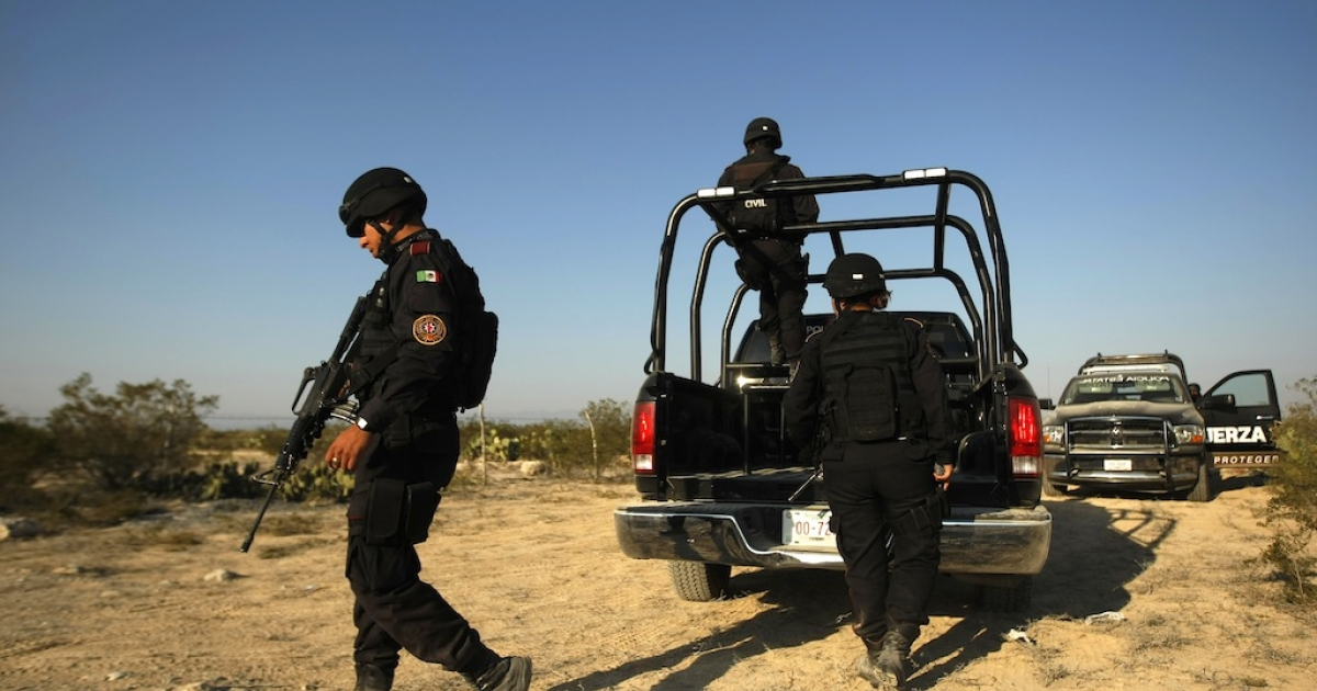 Mexican police conduct a searchin the site where the bodies of the members of the musical Band Kombo Kolombia were found, in Hidalgo municipality, New Leon state, Mexico, on January 28, 2013.</p>