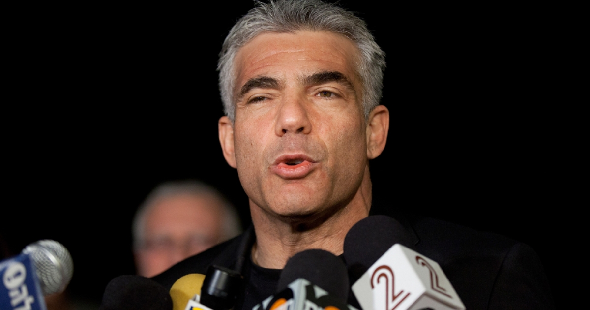 Yair Lapid, leader of the Yesh Atid party, speaks to members of the press outside his house following his unexpectedly strong showing in this week's elections on Jan. 23, 2013 in Tel Aviv, Israel.</p>