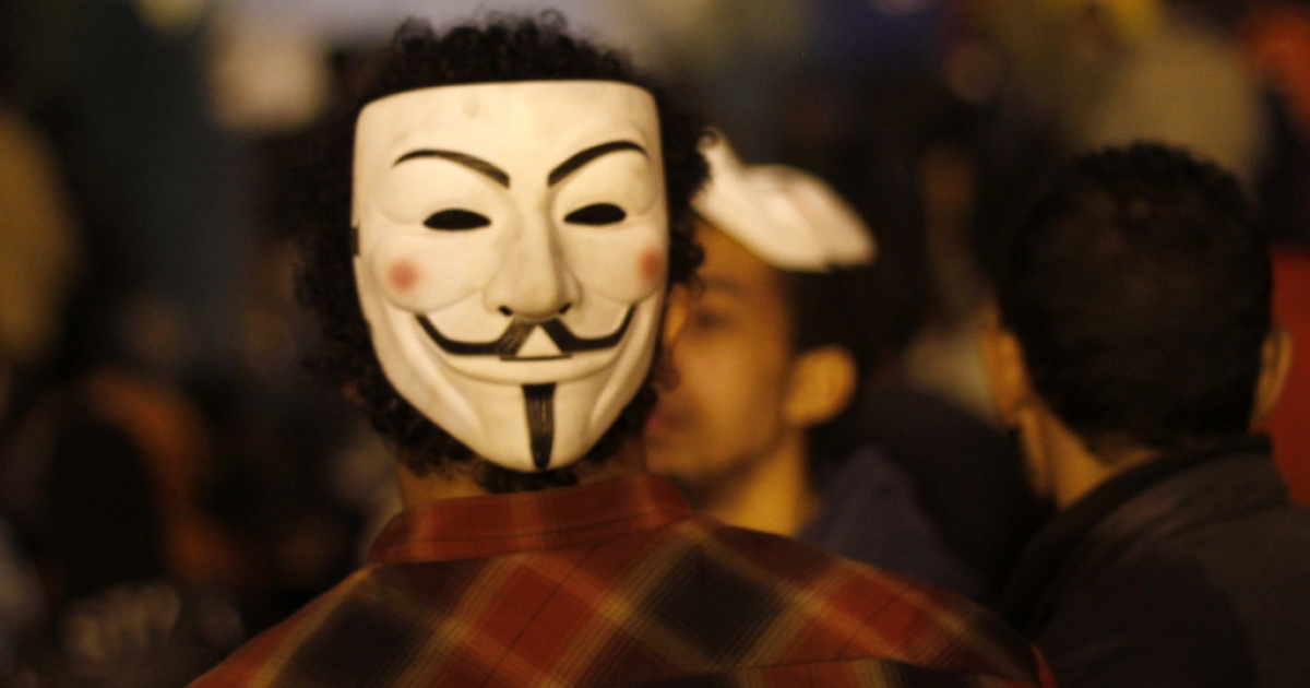 An Egyptian protester wears a mask of the Anonymous movement during a protest in Tahrir Square to call for the fall of Islamist President on Jan. 24, 2012 in Cairo.</p>