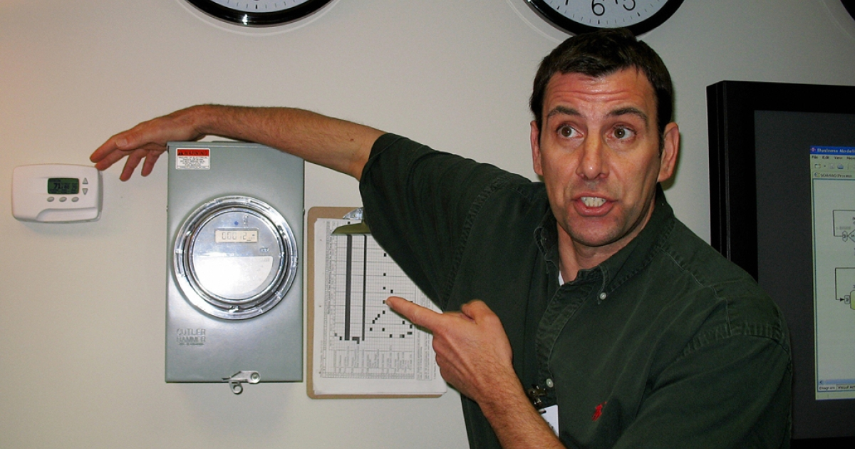 IBM Information Technology Architect Jeff Mausolf points out a computerized electric meter (C) and a