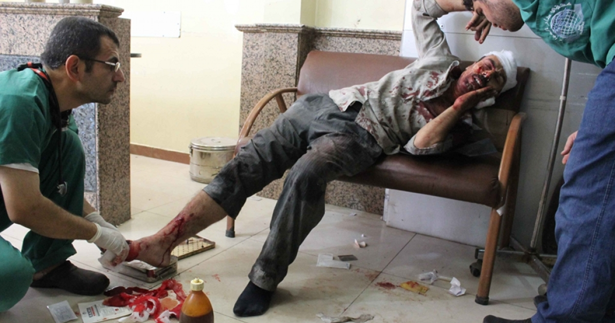 A wounded Syrian man receives medical treatment at a hospital in the northern Syrian city of Aleppo on Sep. 20, 2012. Doctors in the region risk imprisonment, torture, and death at the hands of Assad's forces if they continue to treat injured civilians and rebels.</p>