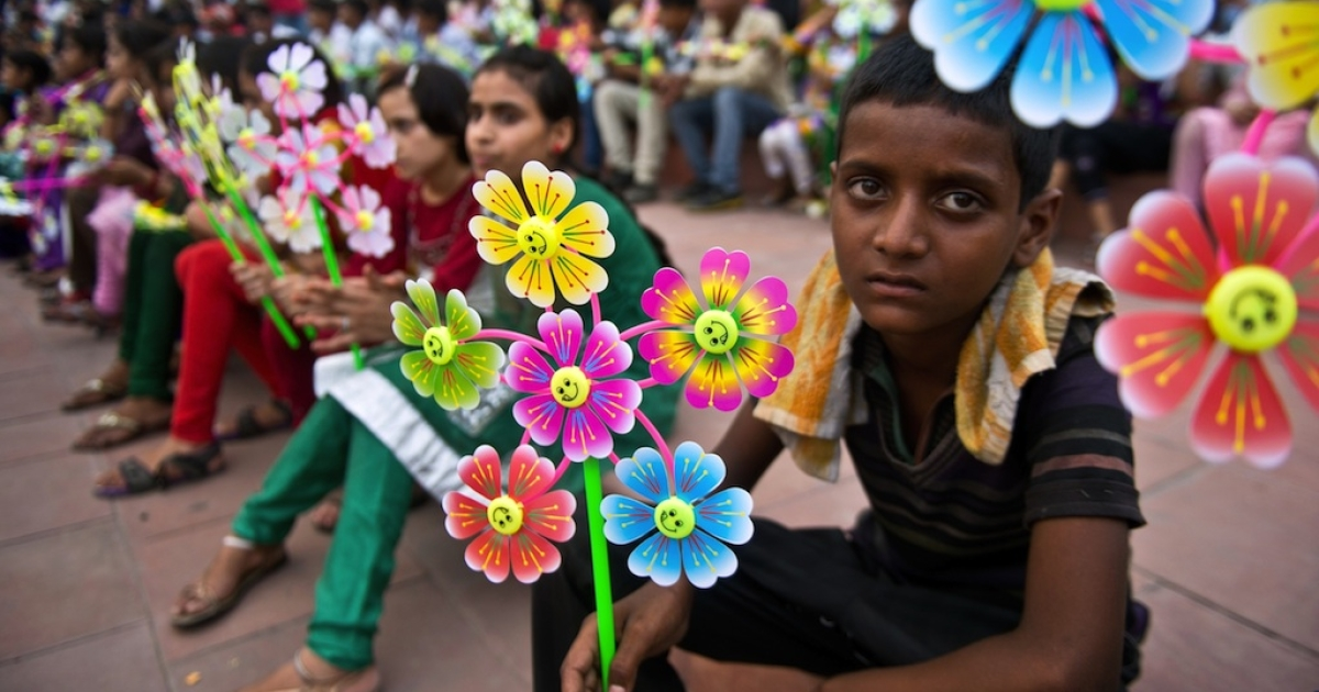 A young Indian boy holds a flower-shaped pinwheel, with each petal representing a child death caused by malnutrition, during a Global Day of Action against Global Hunger event in New Delhi on June 7, 2013. The event was held ahead of the Hunger Summit in London hosted by the UK and Brazilian governments calling for action on global hunger.</p>