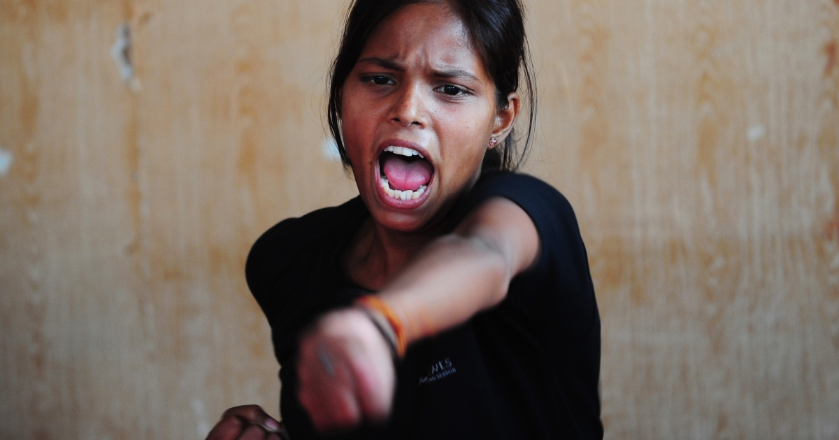 A member of India's 'Red Brigade' takes part in self defense classes at a martial arts academy in Lucknow in May 2013. India's 'Red Brigade' is a group of angry young women challenging deeply ingrained patriarchal mindsets with a message for the country's sexual predators: change your ways or be ready to accept vigilante justice.</p>
