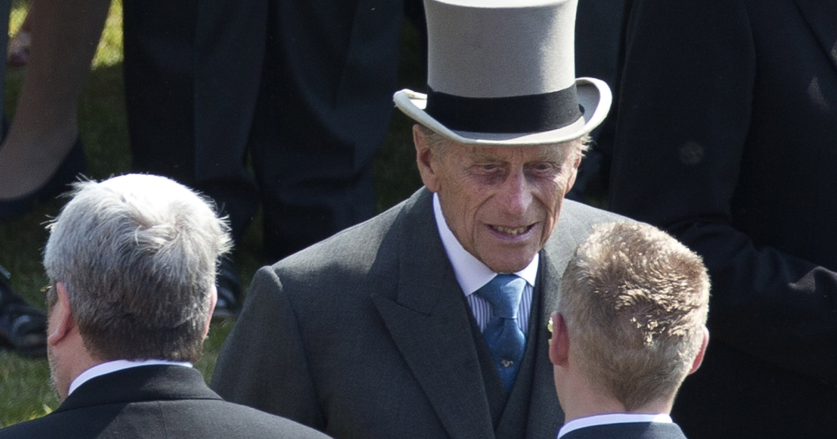 Prince Philip, center, the husband of Britain's Queen Elizabeth II attends a garden party at Buckingham Palace in London, Thursday, June 6, 2013.  Shortly after the party Prince Philip was taken to hospital for abdominal issues.</p>
