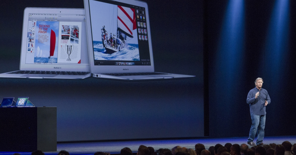Apple Senior Vice President of Worldwide product marketing, Phil Schiller, introduces the new MacBook Air at a keynote address during the 2013 Apple WWDC at the Moscone Center on June 10, 2013 in San Francisco, California. Apple's annual developer conference runs through June 14.</p>