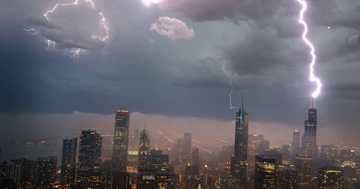 Lightning strikes the Willis Tower (formerly Sears Tower) in downtown on June 12, 2013 in Chicago, Illinois.</p>