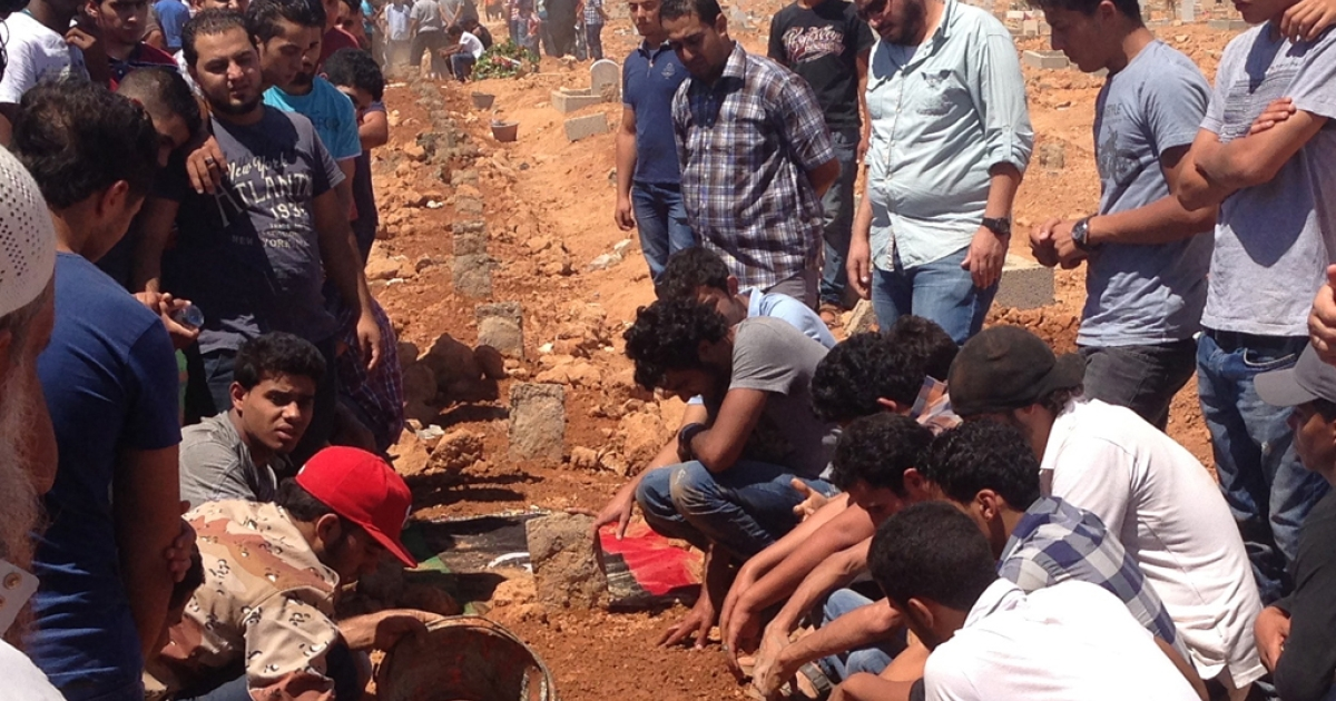 On Sunday, June 9, hundreds of residents in Benghazi came to the cemetery after services at local mosques. In a parched and barren field, the dead were buried by hand in a long row.</p>