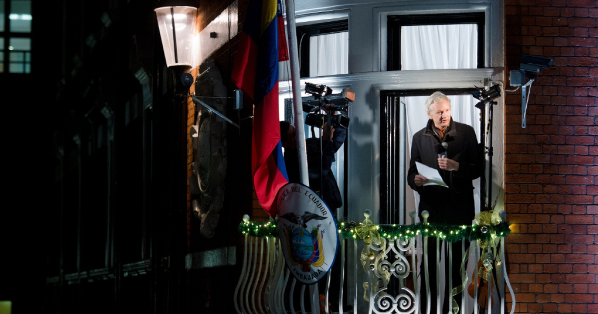 Wikileaks founder Julian Assange addresses members of the media and supporters from the window of the Ecuadorian embassy in Knightsbridge, west London on Dec. 20, 2012.</p>