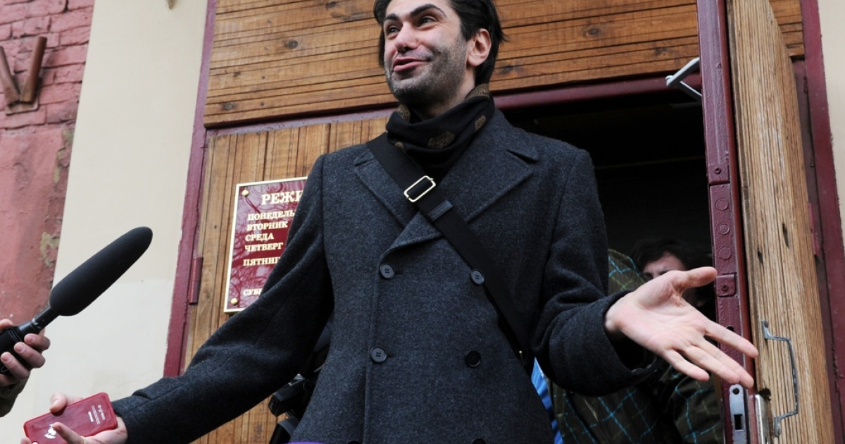 A star dancer at the Bolshoi ballet Nikolai Tsiskaridze leaves a court building in Moscow on April 12, 2013. A Moscow court hears a complaint from Tsiskaridze, who alleges being unfairly treated by the company which blamed him over the acid attack on the troupe's artistic director.</p>