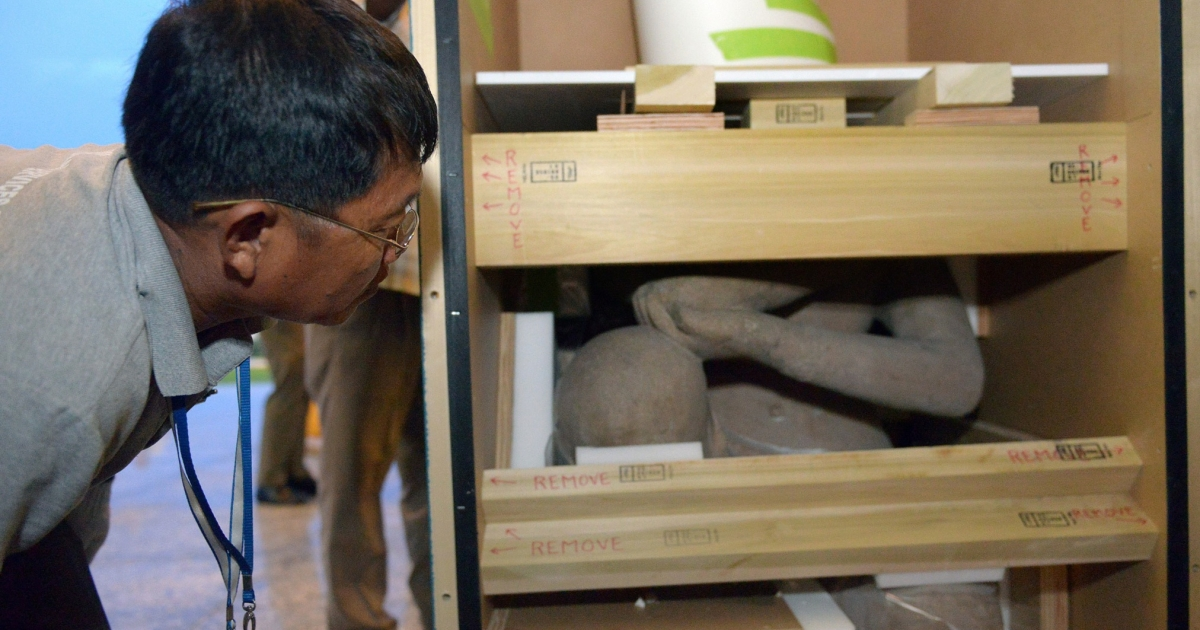 A Cambodian man welcomes homes one of two 10th-century statues that Cambodia says were looted from a jungle temple several decades ago. The pieces were returned on June 11 from New York's Metropolitan Museum of Art, in what the kingdom described as a 'historic' moment.</p>
