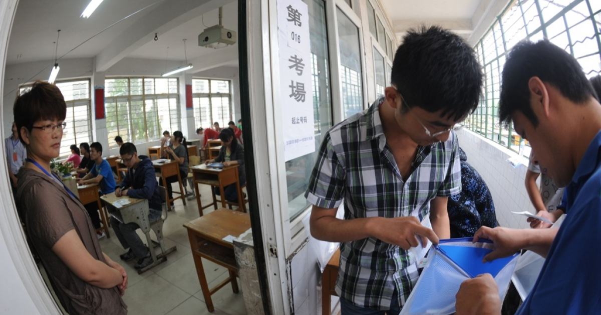 A student has his belongings searched before he enters the room to take China's tough college entrance exams, or gaokao, in Bozhou, Anhui province on June 7, 2012.</p>
