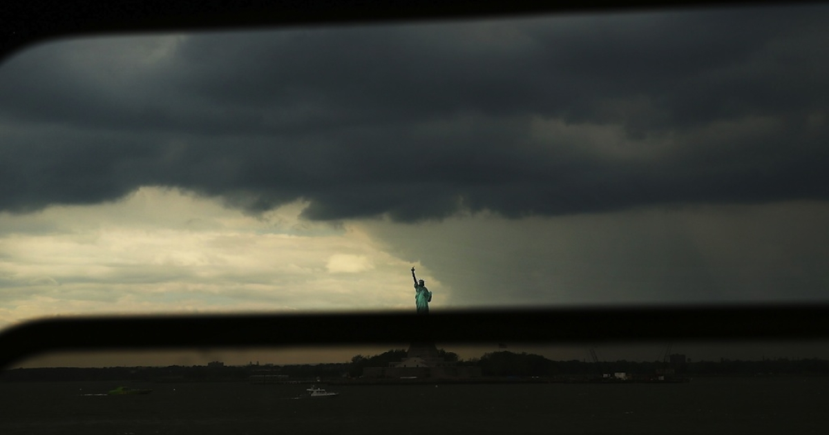 The Statue of Liberty is seen from the Staten Island Ferry on June 11, 2013 in New York City as much of the United States braces for serious storms.</p>