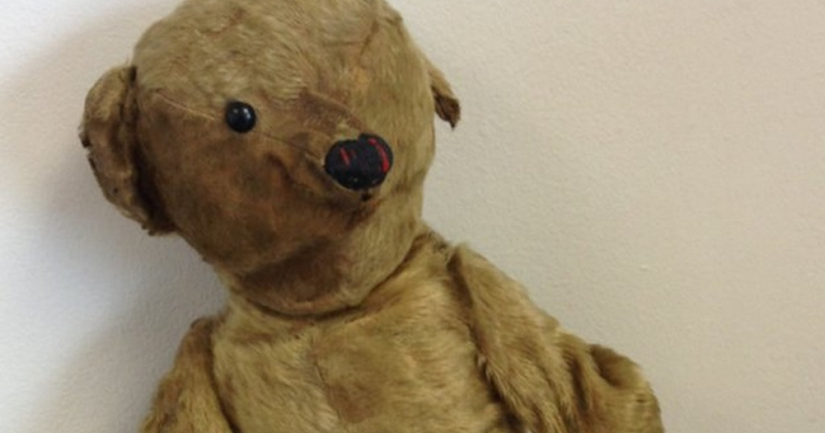 A handout picture released by Bristol Airport on June 4, 2013 shows antique teddy bear Glyn, who was left in the airport's departures lounge last year along with a photograph dated 1918.</p>