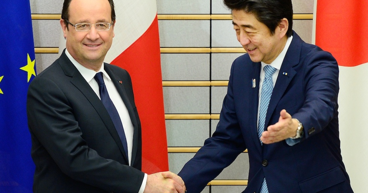 French President Francois Hollande (L) is welcomed by Japanese Prime Minister Shinzo Abe (R) prior to their meeting at Abe's official residence in Tokyo on June 7, 2013. Hollande went on to call the Japanese people 'Chinese' during a speech.</p>