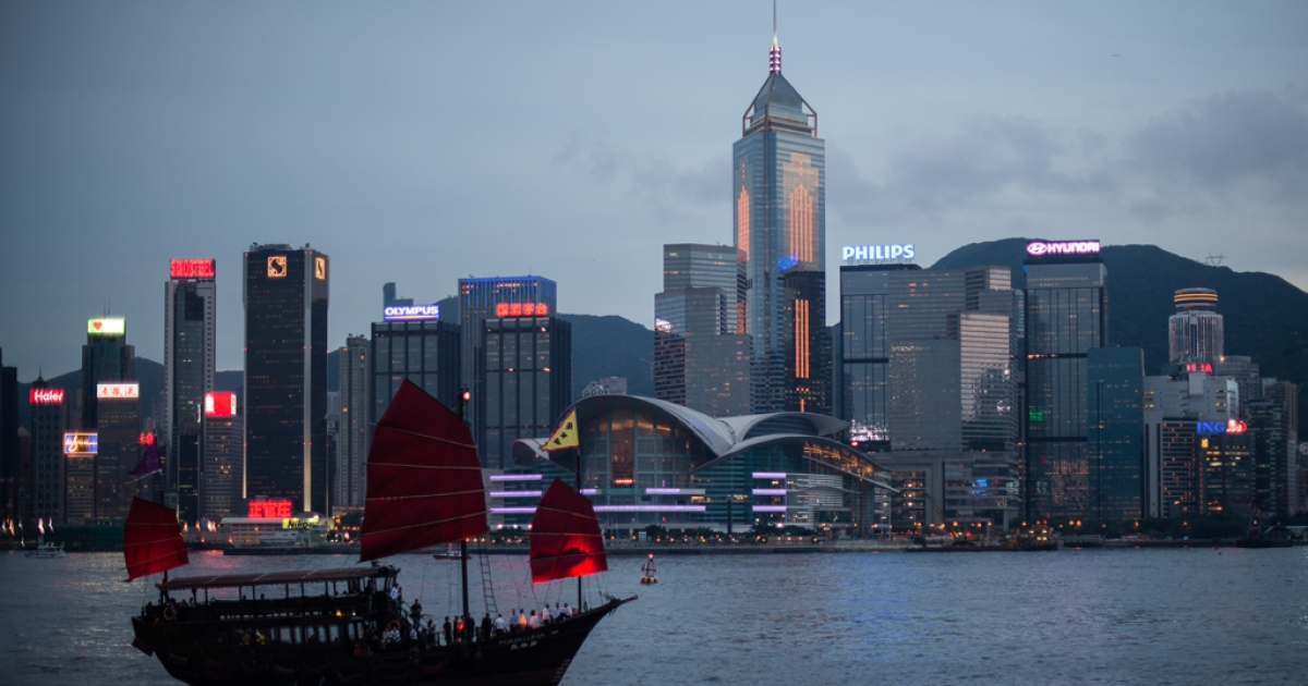 A junk sails on Victoria Harbour in front of the Hong Kong skyline on June 3, 2013.</p>