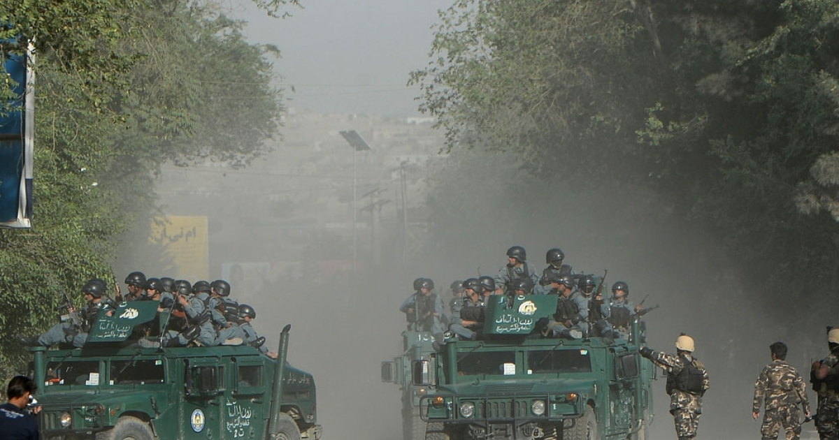 Afghan policemen arrive at the site of a suicide attack in Kabul on June 11, 2013. A suicide car bomber on June 11 rammed a bus packed with staff of Afghanistan's top court, killing 14 and wounding 38 other civilians, mostly Supreme Court employees leaving work, police said.</p>