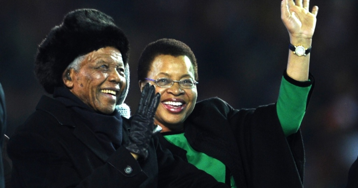 South Africa's former President Nelson Mandela and his wife Graca Machel arrive during the closing ceremony prior to the 2010 World Cup football final Netherlands vs. Spain on July 11, 2010 at Soccer City stadium in Soweto, suburban Johannesburg.</p>