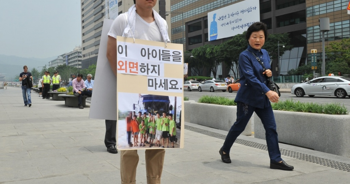 An activist protests in Seoul, South Korea, over the forced repatriation of nine young North Koreans who had fled to Laos. South Korea's president has warned Pyongyang not to harm the returnees.</p>