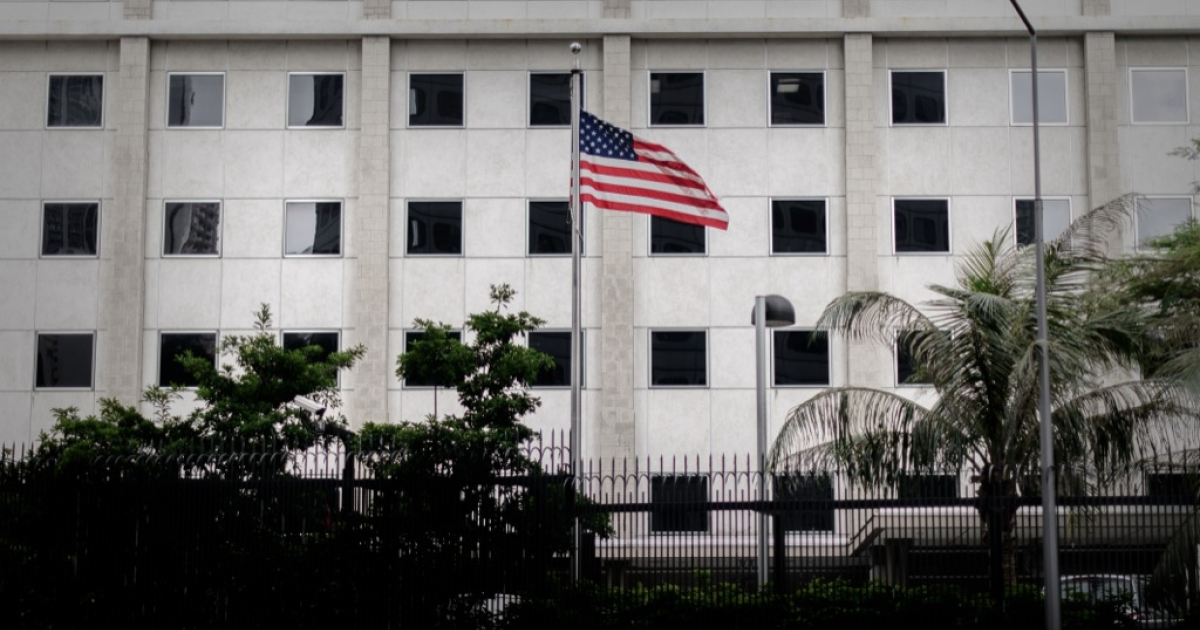 The US flag flutters in front of the US consulate in Hong Kong on June 10, 2013. Edward Snowden, a 29-year-old US government contractor and the source who leaked details of a vast secret US program to monitor Internet users was reported to be in Hong Kong and remained there ever since, holed up in a hotel room.</p>