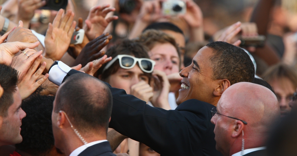 Barack Obama greets elated supporters in Germany after his July 2008 speech in Berlin.</p>