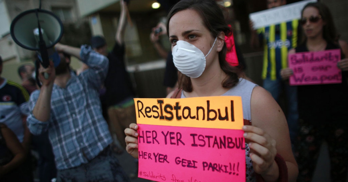 A protester holds a sign as Israelis and Turks demonstrate against the Turkish regime outside the Turkish Embassy in Tel Aviv on June 2, 2013. Turkish police fired tear gas at protesters in Ankara while thousands of people occupied Istanbul's main Taksim Square on the third day of mass demonstrations against Turkey's Islamist-rooted government.</p>