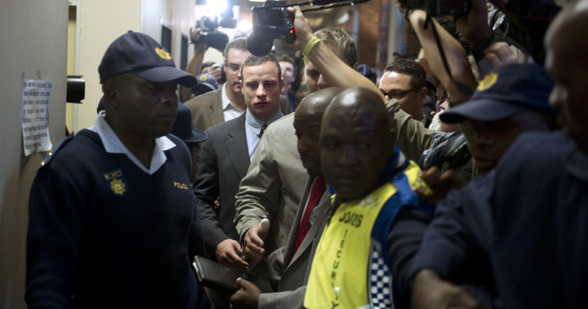 South African Paralympic sprinter Oscar Pistorius (C) leaves on June 4, 2013 the Magistrate Court in Pretoria after appearing for the first time since being freed on bail in February over the Valentine's Day killing of his model girlfriend. The 26-year-old appeared for a brief pre-trial hearing, with both defense and prosecutors seeking a postponement as police try to wrap up their investigation of the case.</p>
