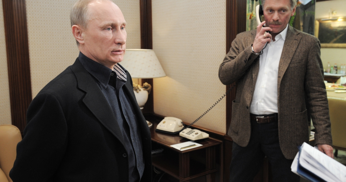 Russia's Prime Minister Vladimir Putin and his spokesman Dmitry Peskov.</p>