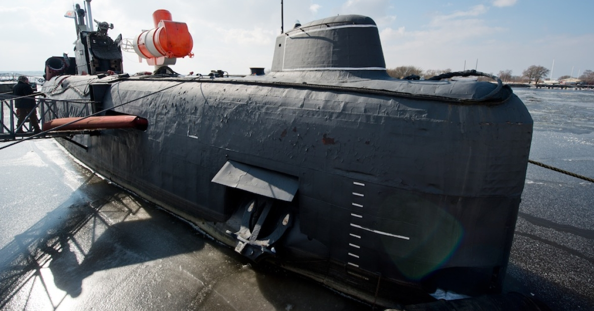 A Russian submarine type JULIETT U 461 lies in the frozen water at the Maritime Museum in Peenemuende, east-northernGermany, on March 15, 2013.</p>