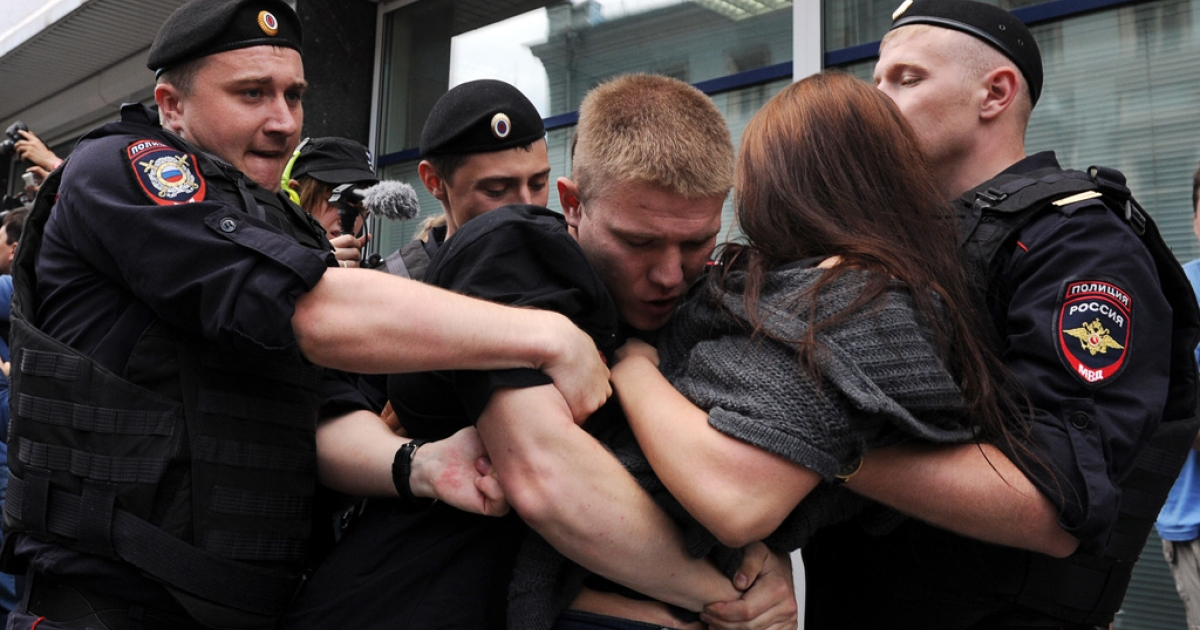 June 11, 2013- Police officers detain gay rights activists protesting outside the State Duma in Moscow against a bill signed by Russia's parliament yesterday, banning homosexual