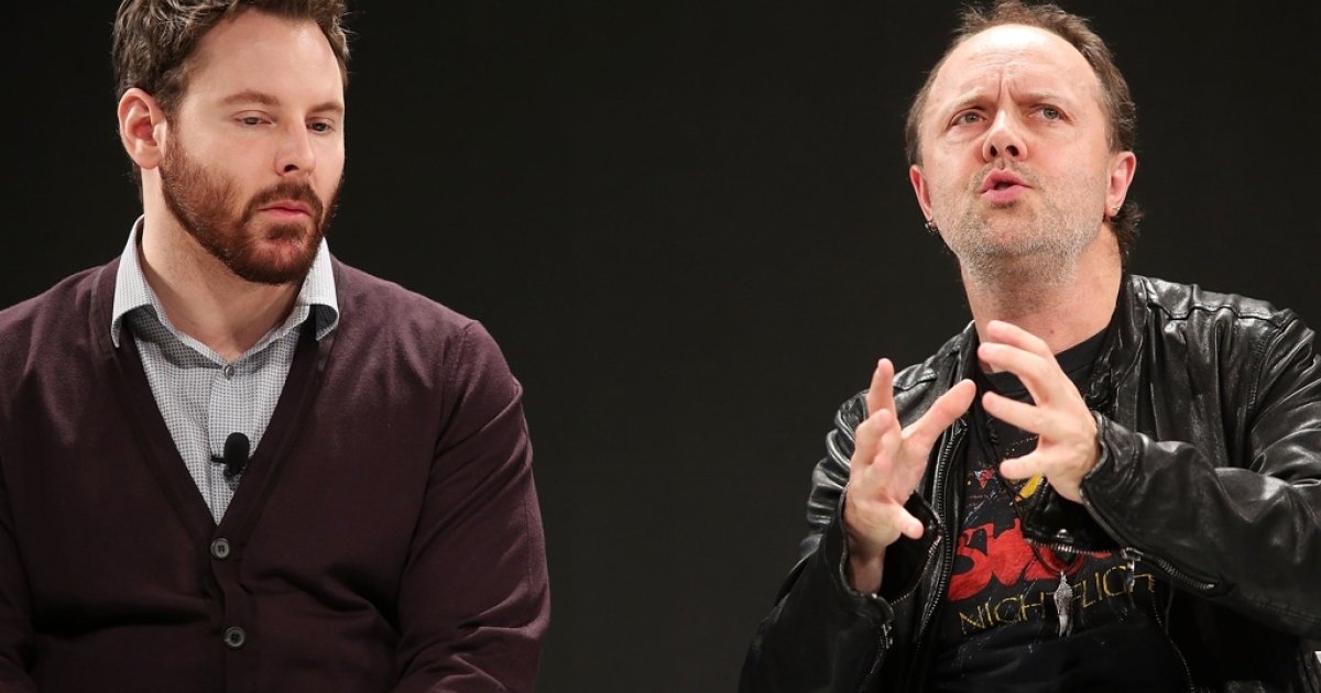 Napster co-founder and former Facebook president Sean Parker (L) speaks with Metallica drummer Lars Ulrich at a Spotify event on December 6, 2012 in New York City.</p>