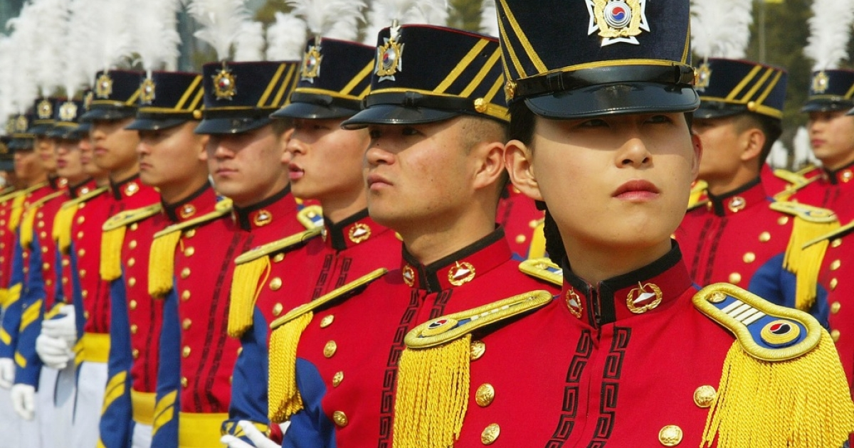 South Korean cadets parade during the 60th graduation ceremony at an army military academy on March 9, 2004 in Seoul, South Korea.</p>