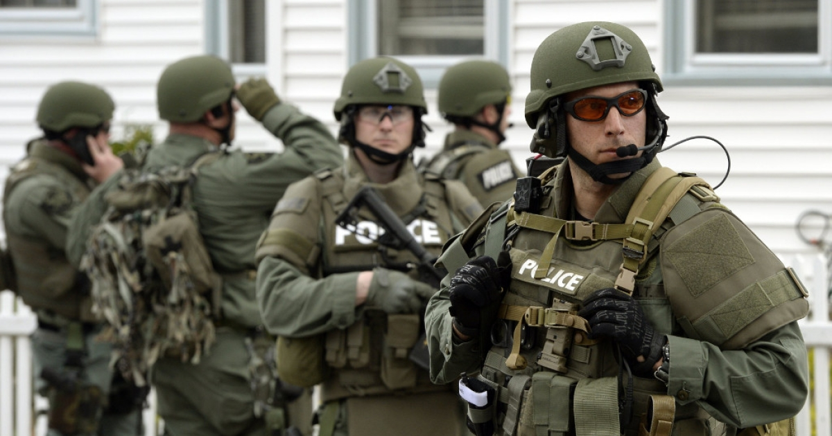 A US police SWAT team searches houses after the Boston Marathon bombings in April.</p>
