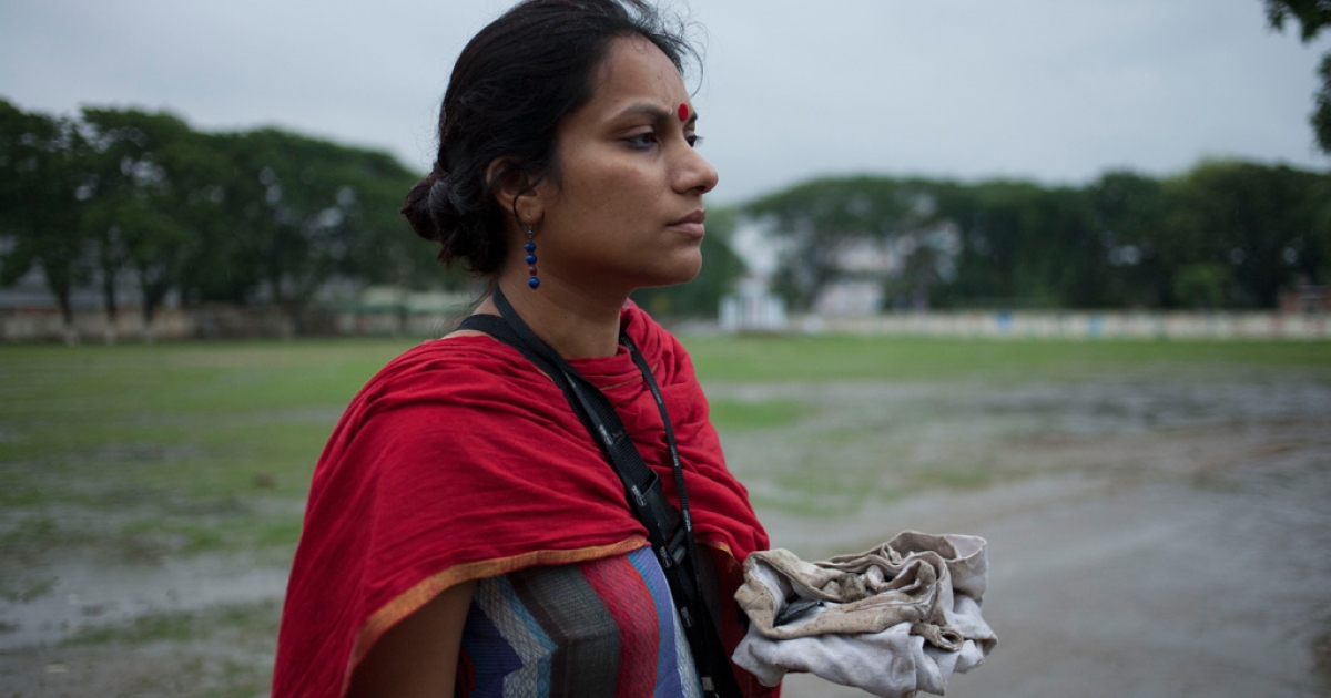 Gulrukh collects found belongings to remind her of why she fights for labor rights. At the Adharchandra H. School that was used for a morgue, Gulrukh finds a dirty shirt and a capsule of incense.</p>