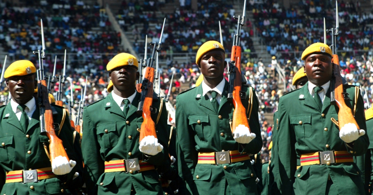 Members of the Zimbabwean national army march past on a parade during defence forces day celebrations in the capital Harare in 2011.</p>