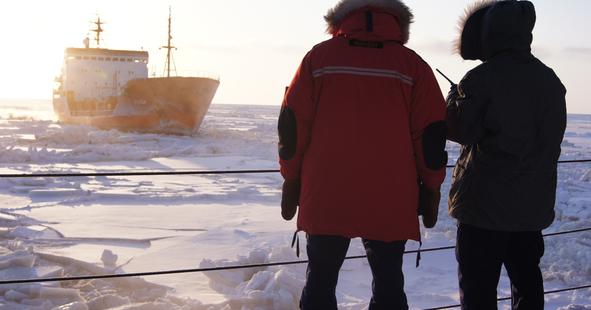 Crew members of the US Coast Guard Cutter Healy observe the Russian tanker vessel Renda as it follows their trail through the ice toward Nome, Alaska January 8, 2012 in the Bearing Sea.</p>