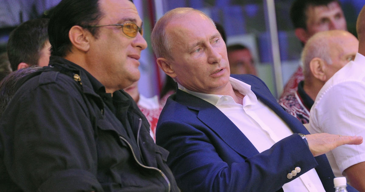 Russian President Vladimir Putin speaks with US actor Steven Seagal during the Mixed fight Championship in the Russian Black Sea resort of Sochi on August 11, 2012.</p>
