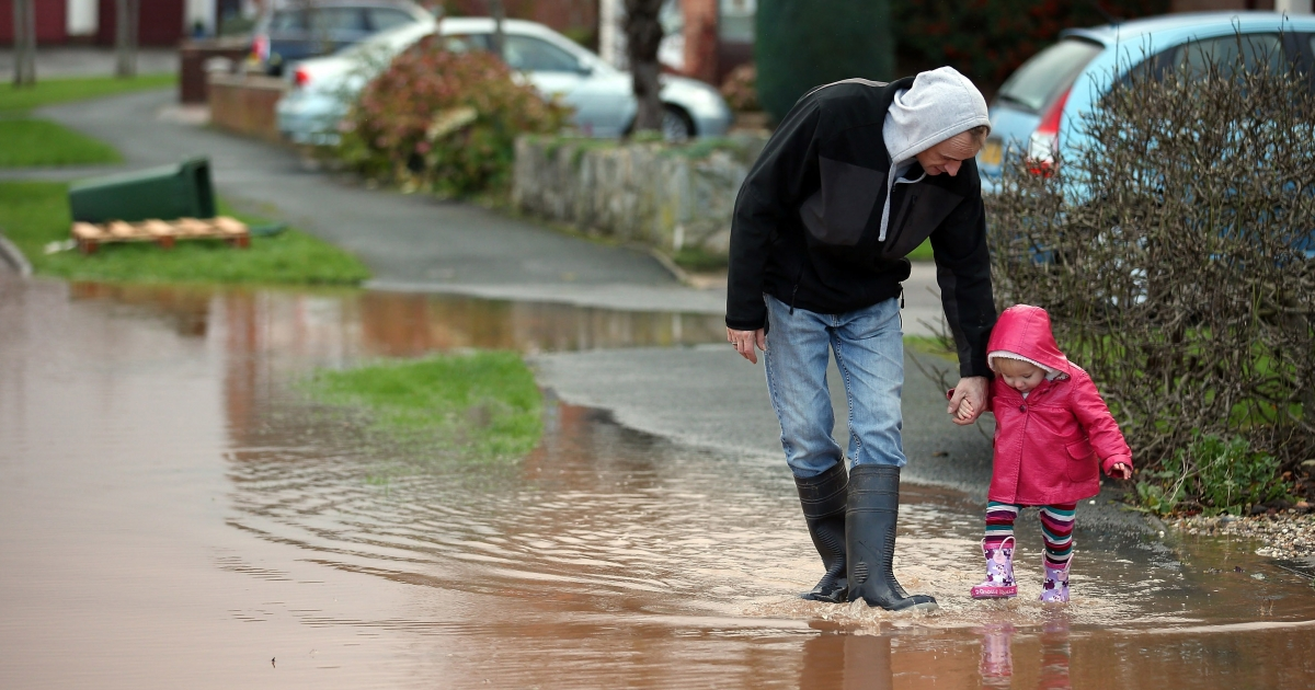 A young girl splashes through flood water in Somerset, England on November 25, 2012.</p>