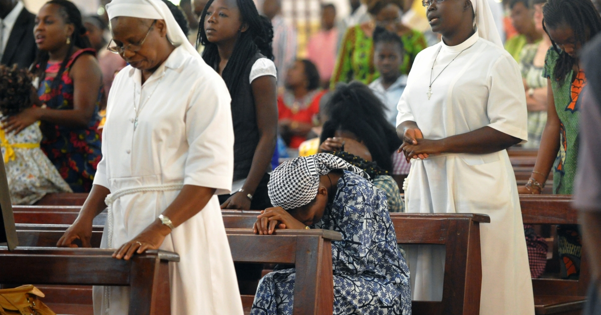 Catholics pray on January 1, 2013 during a Mass for peace held at a cathedral in Bangui, the capital of Central African Republic. In a matter of weeks, fighters from the CAR's Seleka rebel coalition took over large swathes of the impoverished equatorial country.</p>
