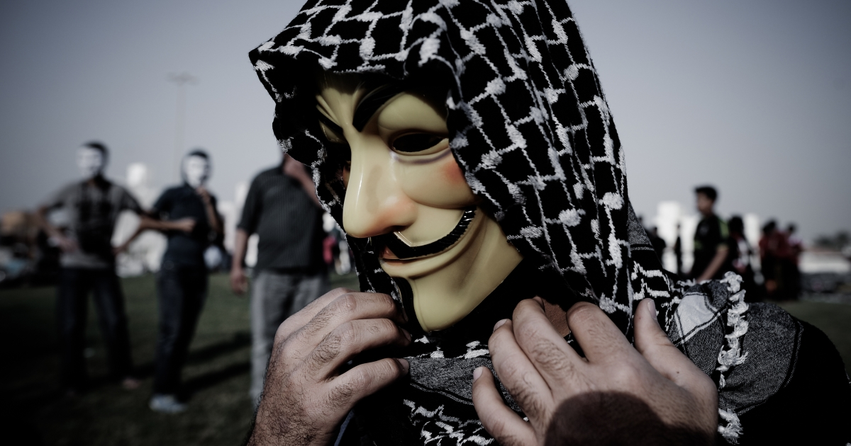 A Bahraini protester wearing a Guy Fawkes mask used by the Anonymous movement takes part in a demonstration against the government and in solidarity with jailed freelance photographer Ahmed Humaidan in the village of Karranah, west of Manama, on March 1, 2013. Humaidan was arrested during a rally on December 29, 2012 and was charged with 'demonstrating illegally' and 'using violence to assault police and damage public properties'.</p>