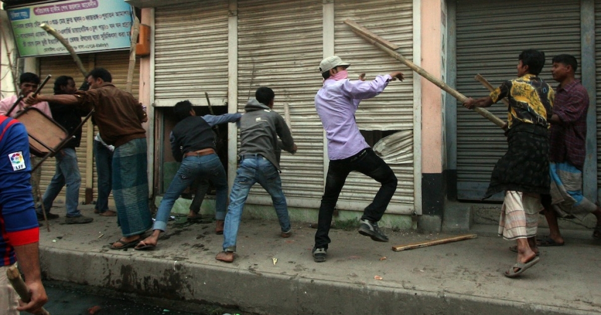 Bangladeshi Islamist activists vandalize shops during clashes with police in Bogra some 120kms north of Dhaka on March 3, 2013. Bangladesh deployed troops in the north of the country after 16 more people were killed in a fresh wave of violence over the conviction of Islamist leaders for war crimes in the Muslim-majority nation.</p>