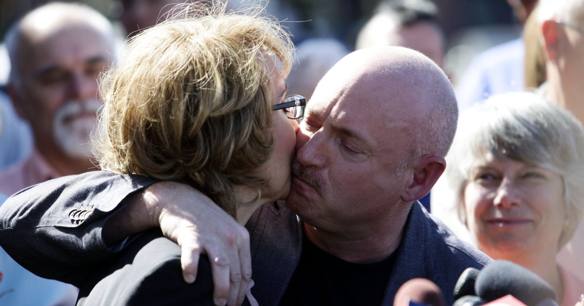 Gabby Giffords receives a kiss from her husband Mark Kelly during a news conference outside Safeway grocery store where they asked Congress to provide stricter gun control in the United States on March 6, 2013 in Tucson, Arizona.</p>