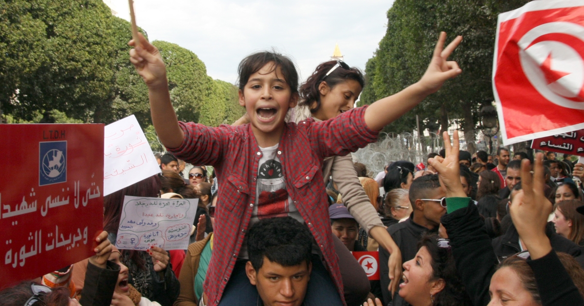 A Tunisian young girl flashes the sign of victory shooting slogans during a demonstration on March 9, 2013 in Tunis.</p>
