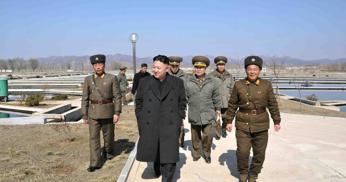 This undated picture released by North Korea's official Korean Central News Agency on March 12, 2013 shows North Korean leader Kim Jong-un (C) inspecting culture ponds of the Ryongjong Fish Farm in South Hwanhae province.</p>
