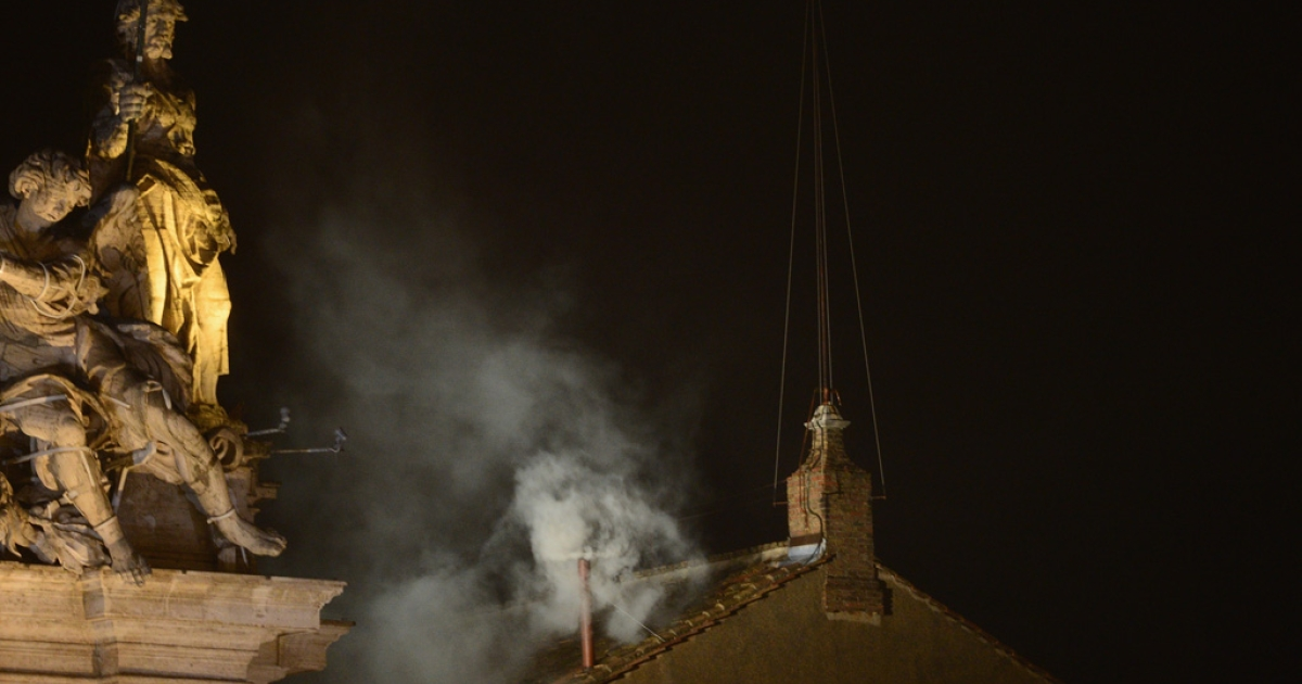 White smoke billows from the Sistine Chapel roof on the second day of the conclave on March 13, 2013 in Vatican City, Vatican. Pope Benedict XVI's successor - the 266th Pontiff - has been selected by the College of Cardinals in Conclave in the Sistine Chapel.</p>