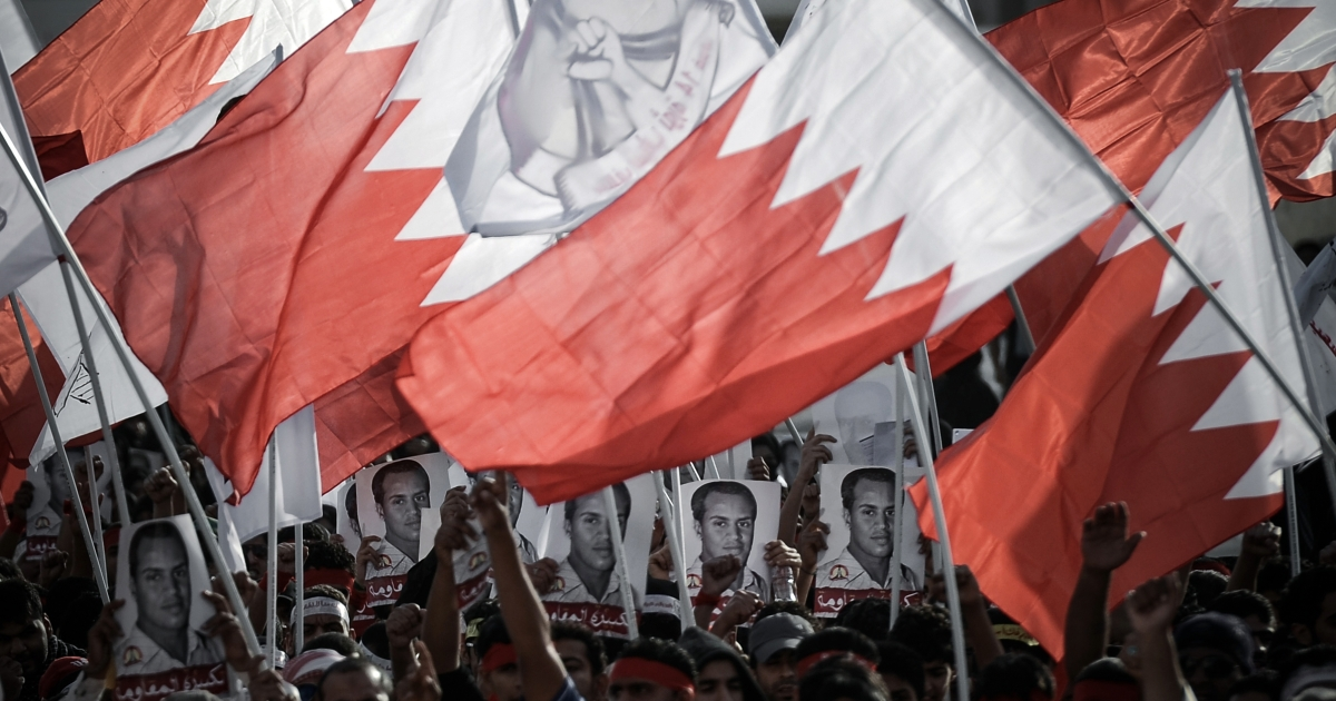 Bahraini protestors wave their national flag during an anti-government rally to demand reforms on March 19, 2013 in the village of Belad al-Qadeem, in a suburb of Manama. Sunni-ruled Shiite-majority Bahrain has seen two years of political unrest linked to opposition demands for a constitutional monarchy that has killed at least 80 people, according to human rights watchdogs.</p>