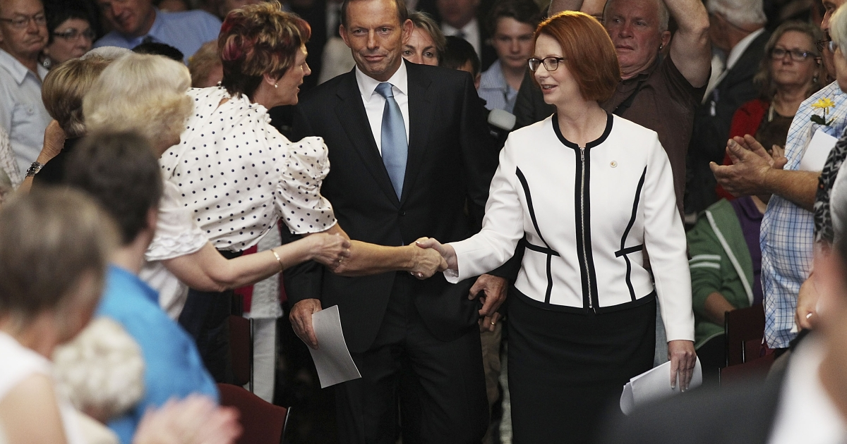 Prime Minister Julia Gillard and opposition leader Tony Abbot arrive in the Great Hall at Parliament House, Canberra.</p>