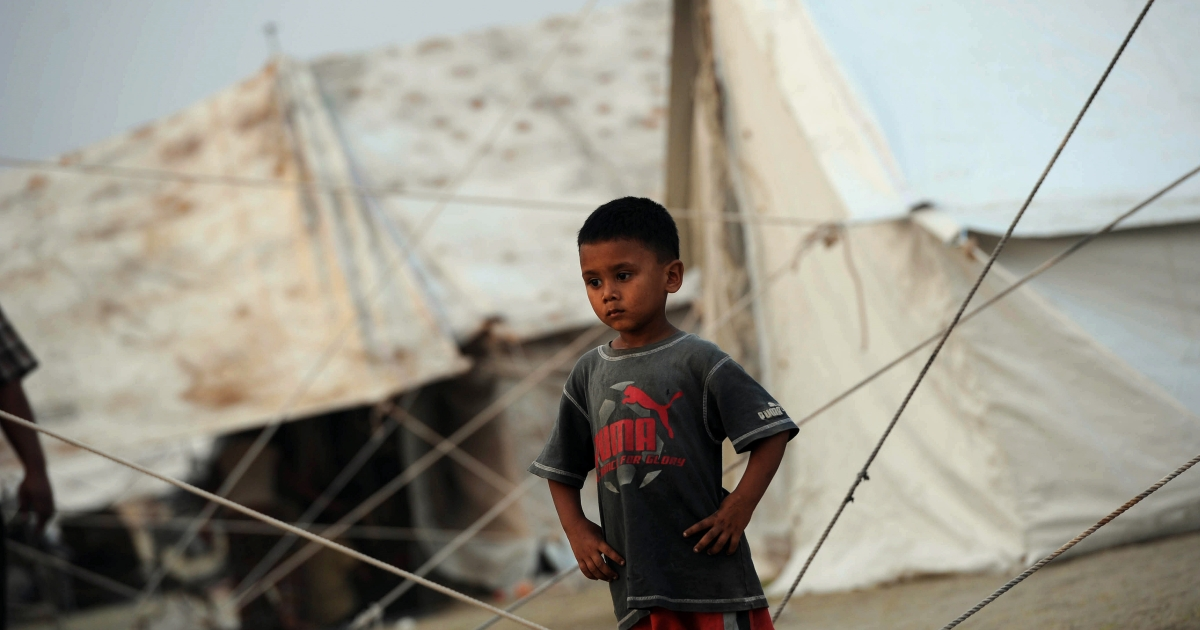 A refugee boy from central Myanmar pictured on March 22, 2013.</p>