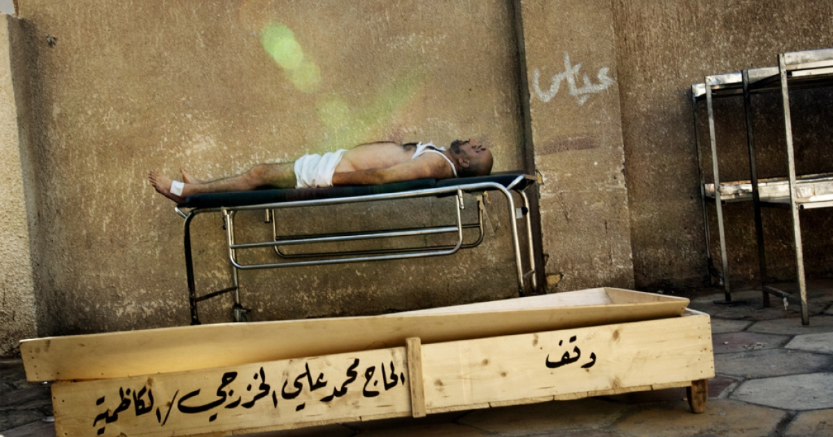 July 26, 2006 - A body rests on a gurney at the Yarmouk hospital morgue in Baghdad, Iraq. Parents make a pilgrimage here every day in search of lost relatives that have disappeared during the night. These photographs are a selection of Franco Pagetti's work in Iraq over the last decade.</p>