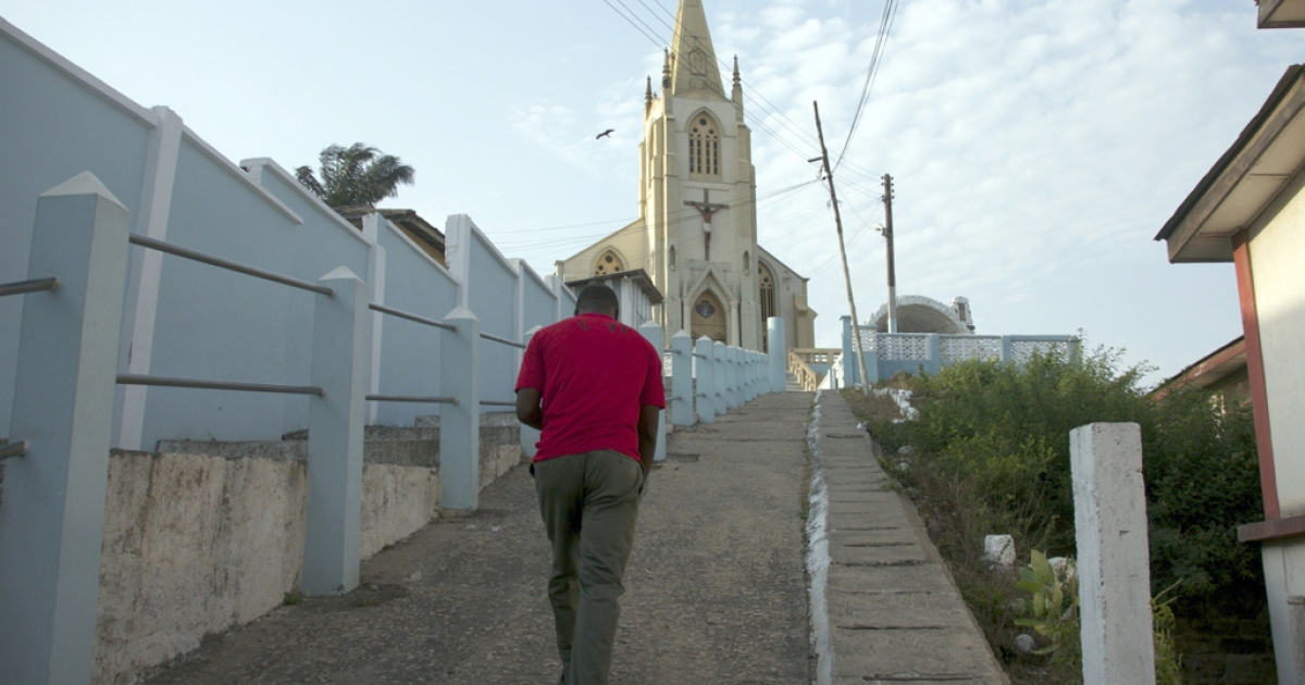 A man walks on February 17, 2013 toward the St. Frances de Sales Cathedral in Cape Coast, Ghana.</p>